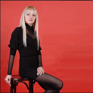Blond lady in black dress and black stockings
